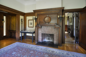 The oak room features a solid wood mantel